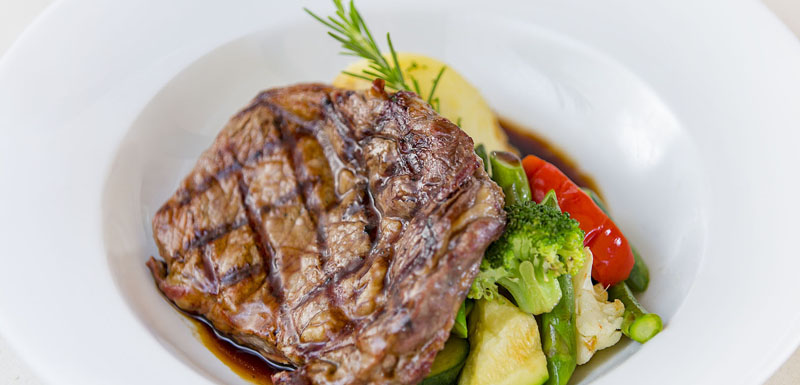 steak and vegetables on plate from popular Cable Beach restaurants delicious seafood menu in Broome, Western Australia