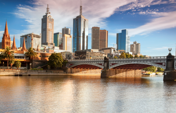 melbourne cbd hotels in the city centre with tourists on holiday overlooking bridge crossing Yarra River in summer with blue skies