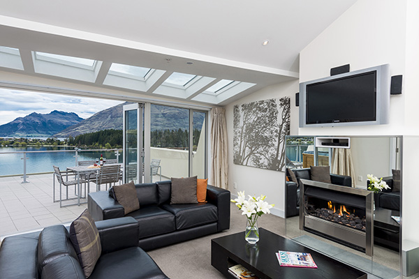 Views Of Beautiful Living Room With Wi Fi Sky TV Fireplace And Spacious Outdoor Balcony