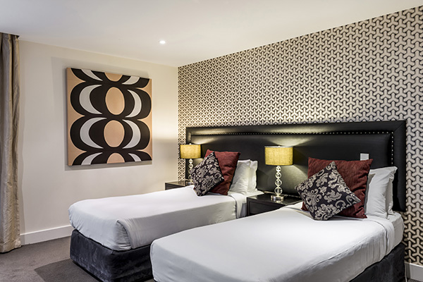 two comfortable single beds for kids with clean sheets in family friendly 3 Bedroom Apartment at Oaks Club Resort hotel in Queenstown, New Zealand