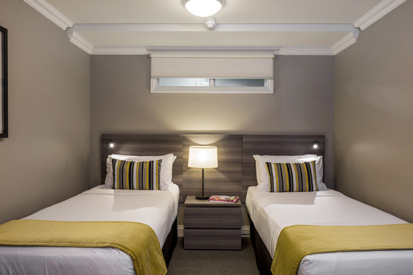 two single beds for kids in family friendly 2 bedroom holiday apartment with Sky TV and Wi-Fi at Oaks Shores hotel in Queenstown, New Zealand