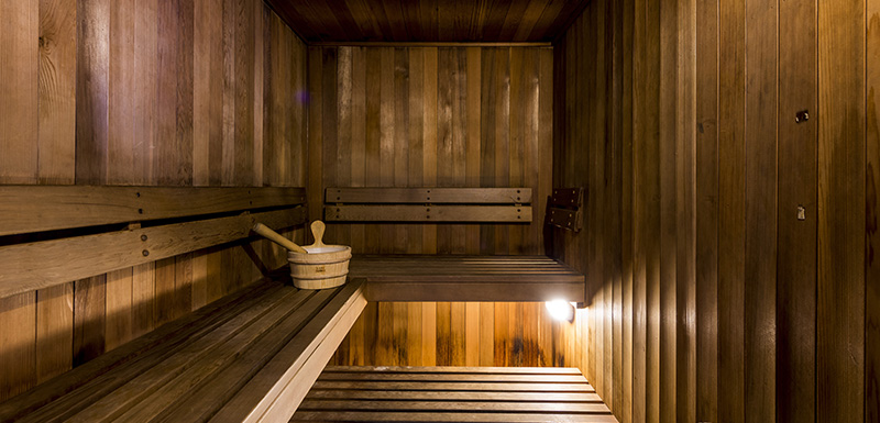 hotel guests enjoying a hot sauna at Oaks Shores resort during their holiday in Queenstown, New Zealand