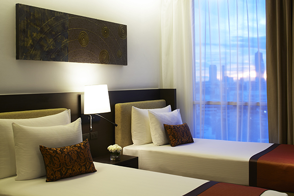 two single beds for kids staying at family friendly 3 Bedroom Suite at Oaks Bangkok Sathorn hotel apartments in Thailand