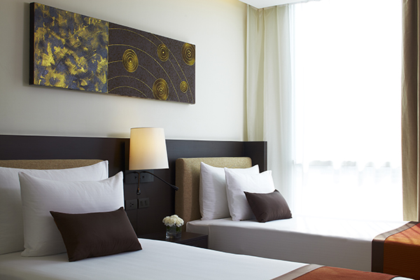 two single beds for children staying in family friendly 2 Bedroom Suite at Oaks Bangkok Sathorn holiday apartments hotel in Thailand