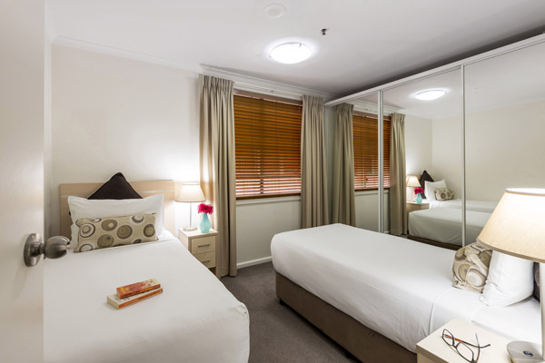 two single beds in 2 bed apartment at Oaks Goldsbrough hotel near Darling Harbour in Sydney