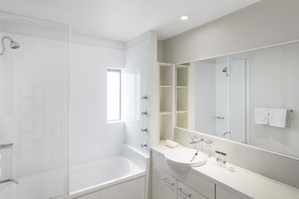 en suite bathroom with shower and bathtub in 1 bedroom apartment at Oaks 212 Margaret hotel, Brisbane, Queensland, Australia
