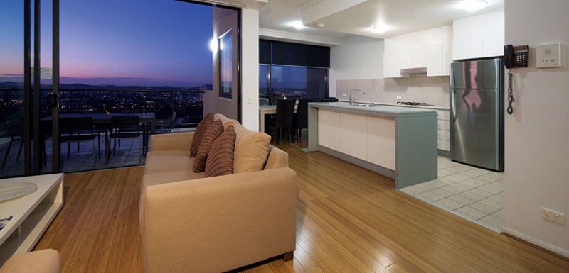 large kitchen in 4 bedroom penthouse with full-size refrigerator, oven, microwave and kettle