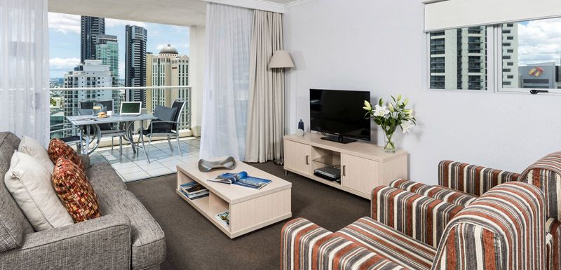 Television And Stereo In Living Room Of 2 Bedroom Apartment At Oaks Lexicon  Apartments In Brisbane