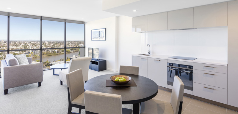 large living room in Hotels Near Suncorp Stadium room with comfortable furniture and big windows at The Milton Brisbane hotel