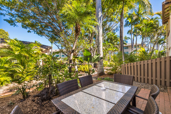 table and chairs on private balcony of 3 bedroom villa at Oaks Oasis Resort hotel in Caloundra on Sunshine Coast, Queensland, Australia
