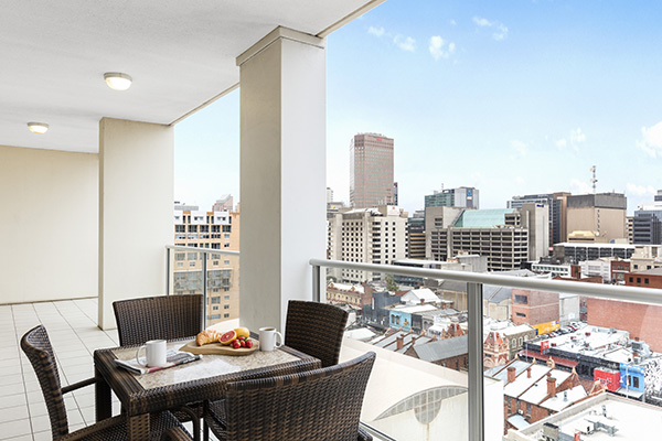 healthy hotel breakfast on table on balcony with views of Adelaide city near Convention Centre