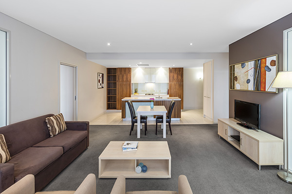 spacious living room with TV, Foxtel and Wi-Fi in family friendly 2 bedroom apartment near Adelaide Zoo