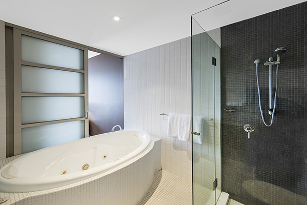 large en suite bathroom in 2 bedroom apartment with spa bath, jacuzzi and shower