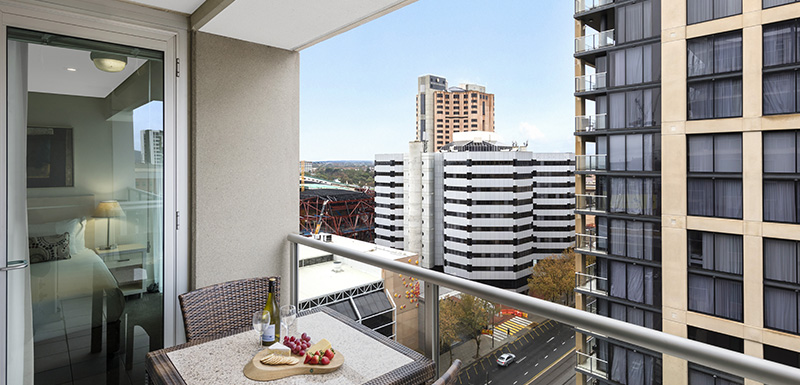 hotels adelaide cbd with big balcony with table and chairs and view of Adelaide CBD at Oaks Embassy 3 bedroom hotel apartment