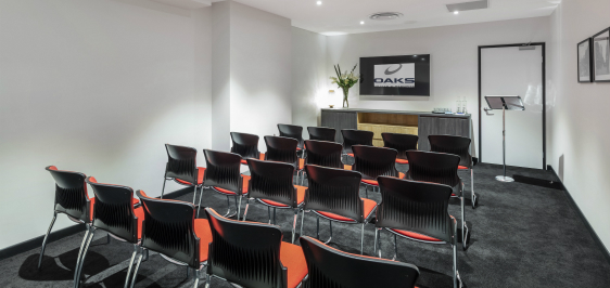 Oaks Embassy Adelaide conferencing room 1 with theater setup with podium, lectern, air conditioning and Wi-Fi access