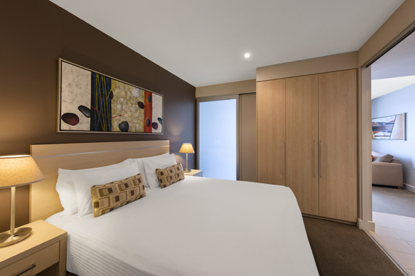 double bed, large wardrobe and en suite bathroom in 2 Bedroom Ocean View Apartment at Oaks Plaza Pier hotel in Glenelg, South Australia