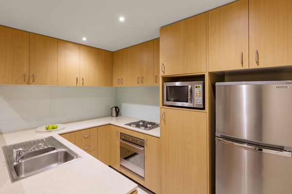 big kitchen with microwave, full-size fridge, large freezer, oven and kettle in 2 Bedroom Executive Apartment with hotel Wi-Fi at Oaks On Lonsdale in Melbourne city, Victoria, Australia