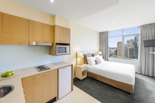 spacious master bedroom in 3 Bed Apartment with microwave, fridge and kettle at Oaks On Lonsdale hotel in Melbourne city, Victoria, Australia