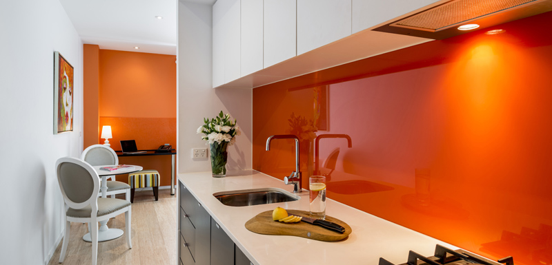 kitchenette with stove cooktop hotplates, microwave, kettle and toaster in 1 bedroom apartment South Yarra hotels with Wi-Fi in Melbourne, Victoria, Australia