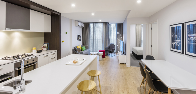 large, open plan 2 Bedroom Apartment with air conditioning and modern furniture at Oaks Southbank hotel in Melbourne city, Victoria, Australia