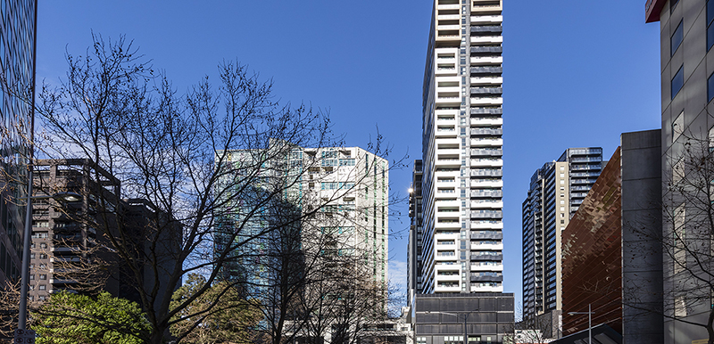 external view of Oaks Southbank hotel in Melbourne city in the distance with blue skies in Victoria, Australia