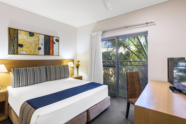 comfortable double bed in air conditioned 1 bedroom apartment with Foxtel at Oaks Broome hotel, Western Australia