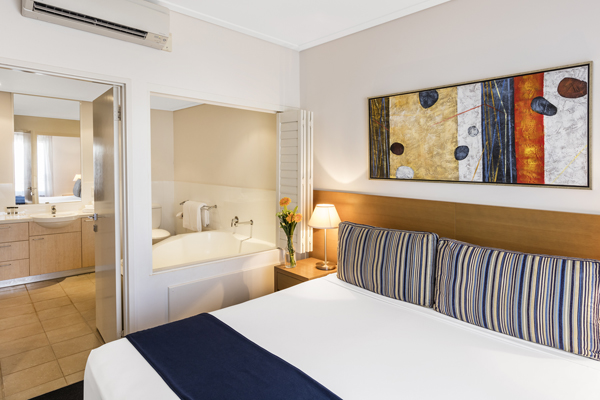 air conditioned 1 bedroom hotel apartment in Broome with en suite bathroom and beautiful artwork on walls in Western Australia