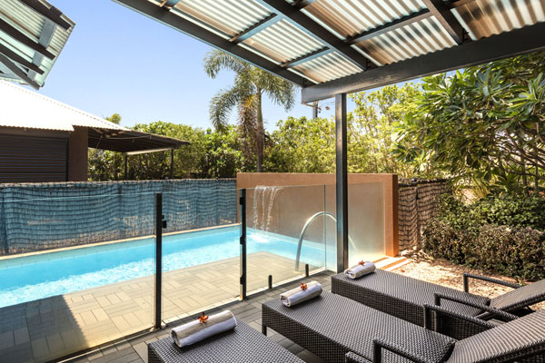 sun loungers in shaded private courtyard next to plunge swimming pool outside 3 Bedroom Apartment at Oaks Cable Beach Sanctuary, Broome, Western Australia during summer