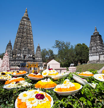 Mahabodhi temple Bodh Gaya India daytime lotus flowers and gifts