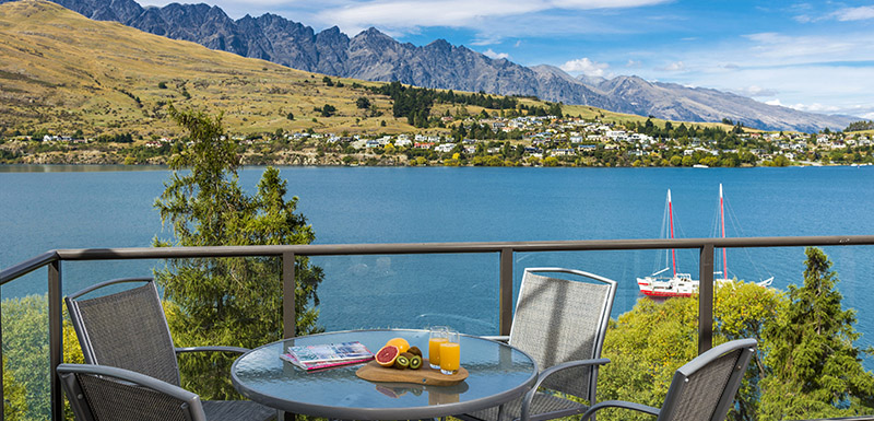 Healthy Fruit Breakfast On Table At Hotels Queenstown Private Balcony Of Hotel Apartment Overlooking Boats