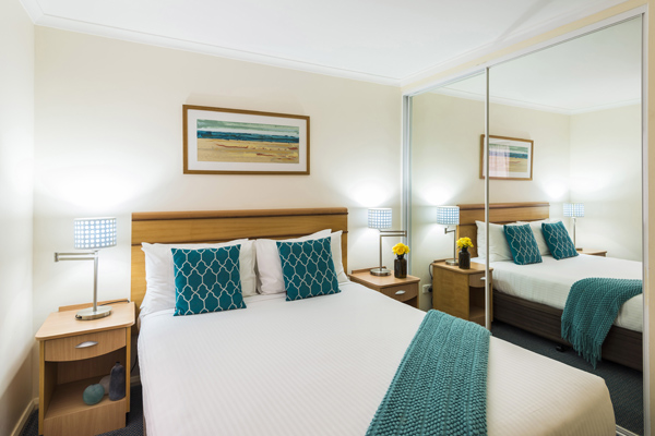 master bedroom in 2 bed apartment at Oaks Waterfront Resort hotel The Entrance NSW