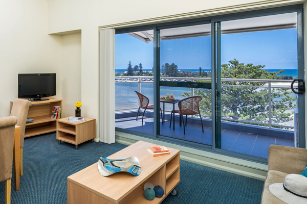 Central Coast resorts living room area in ocean view studio hotel apartment in The Entrance