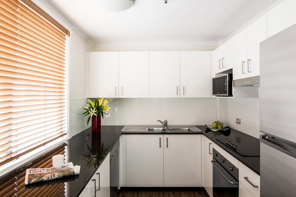 2 bedroom apartment kitchen with full-size fridge, over, cook tops, gas oven and microwave for hotel guests to use