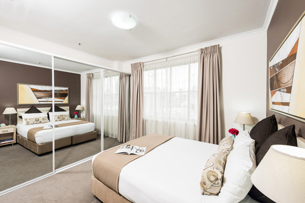 master bedroom in 2 bed hotel room near Darling Harbour in Sydney city