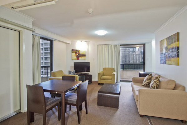 living room in 1 bedroom apartment at Oaks Hyde Park Plaza in Sydney CBD, perfect for corporate travellers