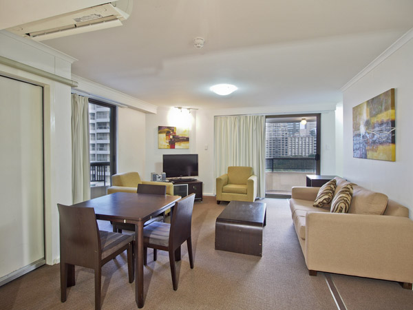 living room in 1 bedroom apartment at Oaks Hyde Park Plaza with balcony and views of Sydney CBD