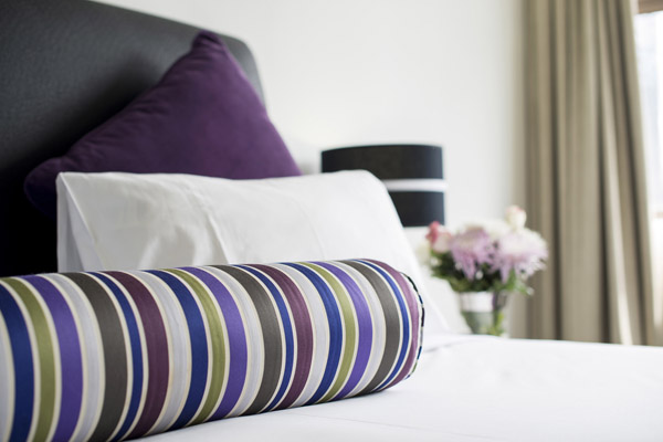 close-up image of pillows on bed in 1 bedroom executive apartment at Oaks Hyde Park Plaza hotel in Sydney
