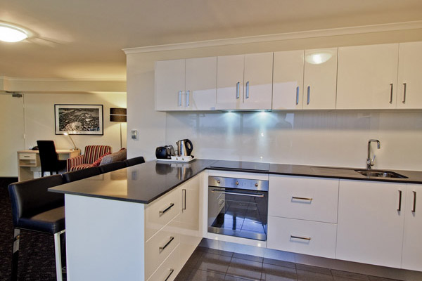 open plan kitchen in 2 bedroom 4 star apartment at Oaks Hyde Park Plaza hotel in Sydney city