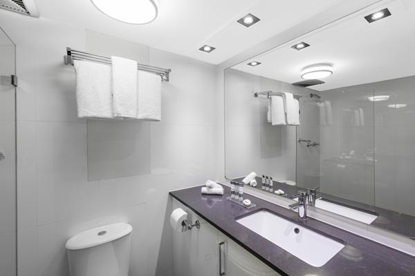 modern en suite bathroom in 2 bedroom hotel apartment at Oaks Hyde Park Plaza, Sydney