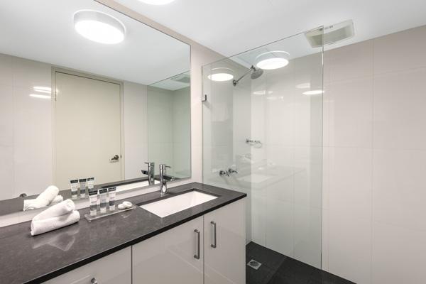 en suite bathroom with shower in 2 bed apartment at Oaks Hyde Park Plaza, Sydney CBD
