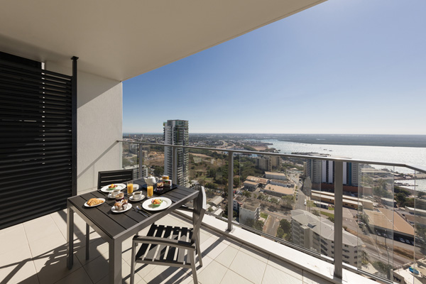 large balcony with breakfast on table in the morning at 2 bedroom apartment at Oaks Elan Darwin hotel