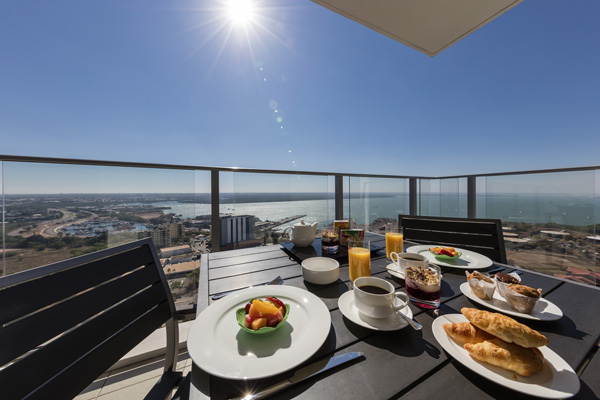 fresh fruit and muesli breakfast on table in the morning at Oaks Elan Darwin hotel 2 bedroom apartment