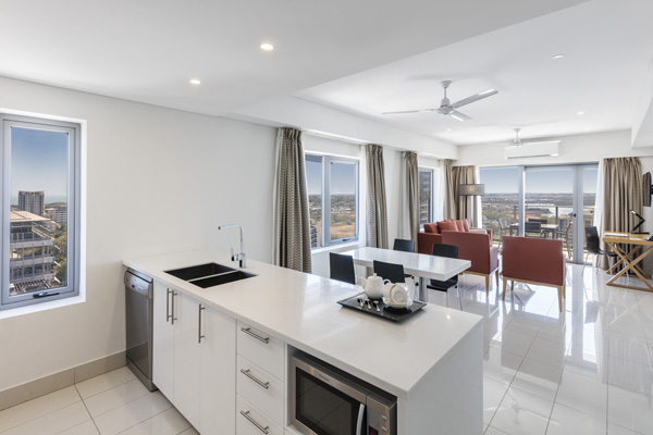 open plan kitchen and living room in 2 bed hotel apartment with microwave and ceiling fan at Oaks Elan Darwin