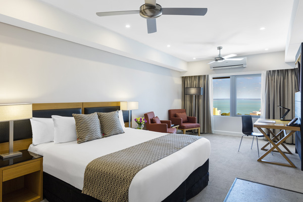 Darwin hotels spacious hotel bedroom with air conditioning at Oaks Elan Darwin, Northern Territory, Australia
