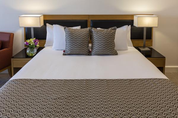 queen size bed in hotel room at Oaks Elan Darwin in Northern Territory Australia