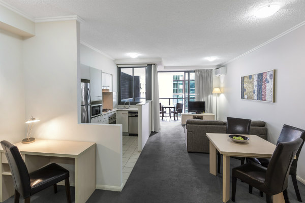 living room area in 1 bedroom hotel apartment with work desk for business travellers visiting Brisbane, Queensland, Australia