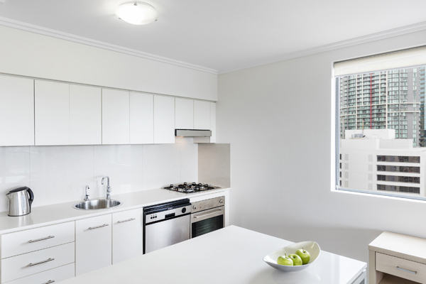 modern kitchen in 2 bedroom apartment with dishwasher, kettle and stove in Brisbane city centre