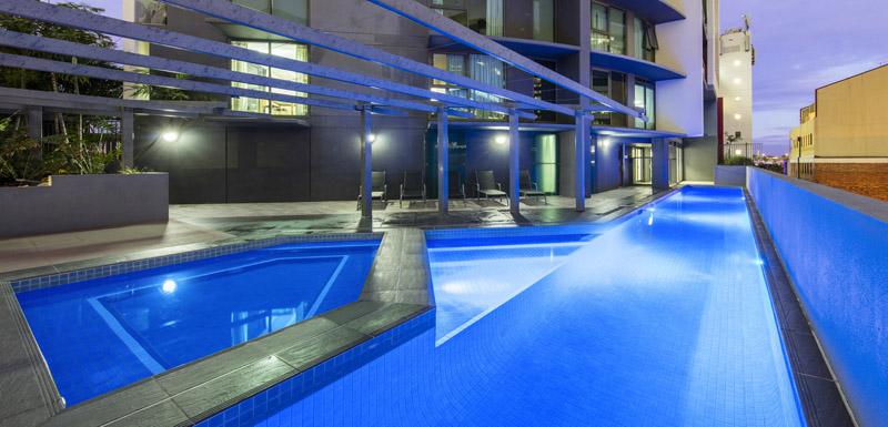 full length outdoor swimming pool at Oaks Felix hotel in Brisbane city centre