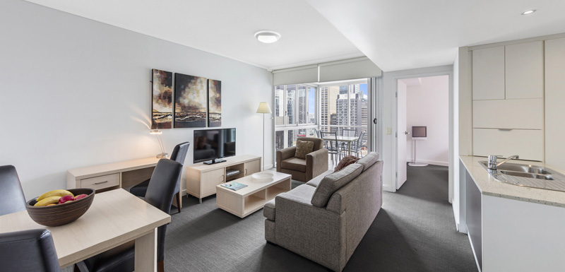 large lounge area with desk for corporate travellers to do work whilst on business trip visiting Brisbane city