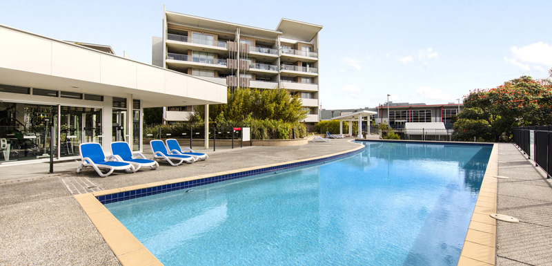 large outside lap pool with sun loungers at Oaks Mews hotel in Bowen Hills, Brisbane